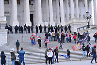 Washington, DC - January 6, 2021: Police protect the U.S. Capitol as thousands of protesters in support of President Donald Trump surround the Capitol building January 6, 2021 as Congress was in session to accept the electors of the November 3 presidential election.  (Photo by Don Baxter/Media Images International)