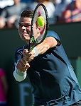 Milos Raonic (CAN) during his quarterfinal match against Rafael Nadal (ESP). Raonic dispatched Nadal in 3 long sets by 46 76(10) 75 at the BNP Parisbas Open in Indian Wells, CA on March 20, 2015.