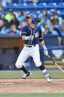 Asheville Tourists right fielder Jonathan Daza (2) swings at a pitch during a game against the Rome Braves at McCormick Field on April 16, 2016 in Asheville, North Carolina. The Braves defeated the Tourists 9-8. (Tony Farlow/Four Seam Images)