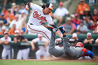 Baltimore Orioles relief pitcher Zach Stewart (50) attempts to tag Jonathan Villar (5) sliding safely into home after a wild pitch during a Spring Training exhibition game against the Dominican Republic on March 7, 2017 at Ed Smith Stadium in Sarasota, Florida.  Baltimore defeated the Dominican Republic 5-4.  (Mike Janes/Four Seam Images)