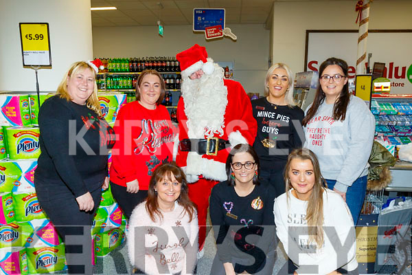 Pictured at the Christmas Fair in Garvey's SuperValu, Tralee on Friday were front l-r: Martina O'Donoghue, Sandra Lynch and Mary Ellen Donovan. Back l-r: Lisa Healy, Ciara Lynch, Santa, Amber Moriarty and Kerri O'Shea.