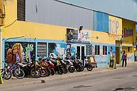 Kralendijk, Bonaire, Leeward Antilles.  Motorbikes and Motorcycles Parked on the Sidewalk.
