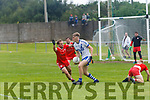St Marys Tadhg O'Connor looks for options as he leaves Watervilles Cillian Cronin on the ground but faces off the challenge of Fergal Cronin.