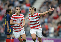 Glasgow, Scotland - Saturday, July 28, 2012: Carli Loyd of the USA Women's soccer team celebrates with Alex Morgan (13) after scoring a goal during a 3-0 win over Colombia in the first round of the Olympic football tournament at Hamden Park.