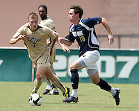 Brendan King #18 of the University of Notre Dame breaks away from Zak Boggs #7 of the University of South Florida during a Big East NCAA match at the University of South Florida on September20 2009, in Tampa, Florida.South Florida won 2-1 .