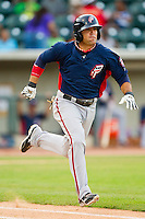 Mike Gilmartin (8) of the Potomac Nationals hustles down the first base line against the Winston-Salem Dash at BB&T Ballpark on July 8, 2013 in Winston-Salem, North Carolina.  The Dash defeated the Nationals 12-9.  (Brian Westerholt/Four Seam Images)
