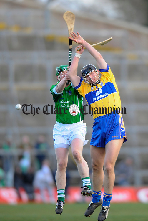Limerick's Maurice O Brien and Clare's Tony Carmody contest a ball during their National League game in Limerick. Photograph by John Kelly.