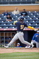 Nick Halamandaris (51) of the California Golden Bears follows through on his swing against the Duke Blue Devils at Durham Bulls Athletic Park on February 20, 2016 in Durham, North Carolina.  The Blue Devils defeated the Golden Bears 6-5 in 10 innings.  (Brian Westerholt/Four Seam Images)