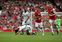 Pictured: Danny Graham of Swansea injured on the ground. Saturday 10 September 2011<br /> Re: Premiership Arsenal v Swansea City FC at the Emirates Stadium, London.