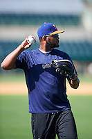 Midland RockHounds pitcher Raul Alcantara (56) throws in the outfield before a game against the San Antonio Missions on April 21, 2016 at Nelson W. Wolff Municipal Stadium in San Antonio, Texas.  Midland defeated San Antonio 9-2.  (Mike Janes/Four Seam Images)