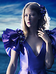 Beauty portrait of a young beautiful blond woman wearing a blue evening dress outdoors Image © MaximImages, License at https://www.maximimages.com