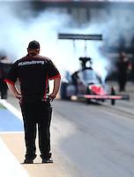 Jun 21, 2015; Bristol, TN, USA; A crew member for NHRA top fuel driver J.R. Todd during the Thunder Valley Nationals at Bristol Dragway. Mandatory Credit: Mark J. Rebilas-