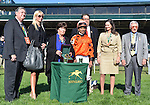 Trainer Dale Romans, jockey Jose Lezcano accept trophy for Tapitsfly's win the First Lady at Keeneland Racecourse.October 6, 2012.