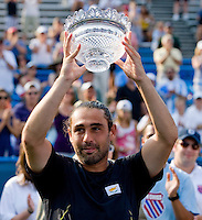 Marcos Baghdatis salutes the crowd with the runner-up trophy during the Legg Mason Tennis Classic at the William H.G. FitzGerald Tennis Center in Washington, DC.  David Nalbandian defeated Marcos Baghdatis in straight sets in the finals Sunday afternoon.