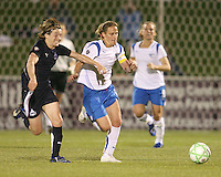 Sonia Bompastor #8 of the Washington Freedom and Kristine Lilly #13 of the Boston Breakers chase down a loose ball during a WPS match at the Maryland Soccerplex, in Boyd's, Maryland, on April 18 2009. Breakers won the match 3-1.