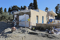 Pictured: Builders reconstruct part of the house -where Ben Needham disappeared from- which had to be demolished for the investigation in Kos, Greece. Friday 14 October 2016<br />