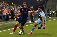 KANSAS CITY, KS - SEPTEMBER 11: Boris Sekulic #2 of Chicago Fire FC and Luis Martins #36 of Sporting Kansas City battle for the ball during a game between Chicago Fire FC and Sporting Kansas City at Children's Mercy Park on September 11, 2021 in Kansas City, Kansas.