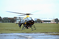 Police air ambulance helicopter in the process of taking off from its base at an airfield. This image may only be used to portray the subject in a positive manner..©shoutpictures.com..john@shoutpictures.com