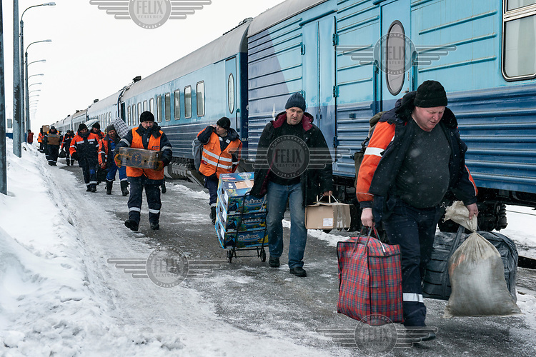 Staff, who are due to start a one to two month shift at the Gasprom Bovanenkovo gas field, load their baggage onto the Obskaya-Bovanenkovo railway train that will take them to their place of work.