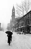 Blizzard of 1996...Greenwich Village, NYC at Sixth Avenue and 11th Street near  Jefferson Market Courthouse/Library. Twin Towers of World Trade center faintly visible in background.