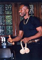 Musician playing an aslatua , Accra, Ghana, Africa.
