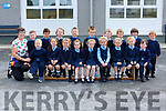 Breda McGaley with her junior infants class who started school in Scoil Mhuire and Naomh Treasa Currow on Monday