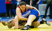 11 MAY 2014 - SHEFFIELD, GBR - Chloe Spiteri (top) attempts to overpower Liz Kay during their women's 63kg category freestyle match at the British 2014 Senior Wrestling Championships in EIS in Sheffield, Great Britain  (PHOTO COPYRIGHT © 2014 NIGEL FARROW, ALL RIGHTS RESERVED)