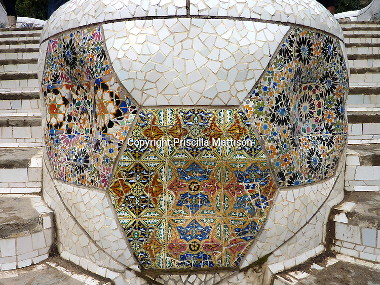 Barcelona, Spain - January 28, 2011:  The front of a planter on the stairs in Parc Guell is decorated with colorful tiles.