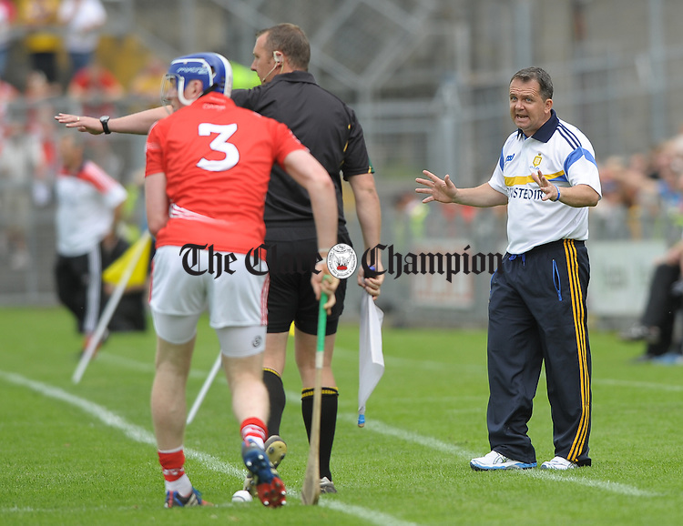 David Fitzgerald Clare Manager has a word for the linesman during the Senior hurling championship semi-final at Thurles. Photograph by John Kelly.