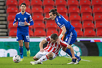 9th January 2021; Bet365 Stadium, Stoke, Staffordshire, England; English FA Cup Football, Carabao Cup, Stoke City versus Leicester City; Sam Vokes of Stoke City goes down as he is tackled by Caglar Soyuncu of Leicester City
