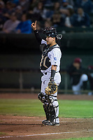 Idaho Falls Chukars catcher Jesus Atencio (31) signals to the defense during a Pioneer League game against the Great Falls Voyagers at Melaleuca Field on August 18, 2018 in Idaho Falls, Idaho. The Idaho Falls Chukars defeated the Great Falls Voyagers by a score of 6-5. (Zachary Lucy/Four Seam Images)
