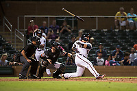 Salt River Rafters catcher Daulton Varsho (8), of the Arizona Diamondbacks organization, loses his bat on a swing in front of home plate umpire Nestor Ceja and catcher Matt Winn (16) during an Arizona Fall League game against the Scottsdale Scorpions at Salt River Fields at Talking Stick on October 11, 2018 in Scottsdale, Arizona. Salt River defeated Scottsdale 7-6. (Zachary Lucy/Four Seam Images)