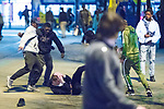 © Joel Goodman - 07973 332324 . 07/04/2017 . Manchester , UK . 6th in a sequence . Five youths on one as a fight breaks out in which a man's head is kicked and stamped upon , in Piccadilly Gardens . Greater Manchester Police have authorised dispersal powers and say they will ban people from the city centre for 48 hours , this evening (7th April 2017) , in order to tackle alcohol and spice abuse . Photo credit : Joel Goodman