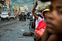 The street of the La Saline market, Port-au-Prince, Haiti, 13 July 2008. Every day thousands of women from all over the city of Port-au-Prince try to resell supplies and food from questionable sources in the La Saline market. The informal sector significantly predominate within the poor Haitian economics and the regular shops virtually do not exist. La Saline is the largest street market area in Port-au-Prince.