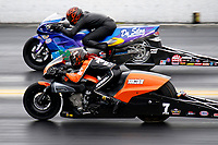 27th September 2020, Gainsville, Florida, USA;  Pro Stock Motorcycle drivers Angelle Sampey (7) and Michael Phillips (412) during the 51st annual Amalie Motor Oil NHRA Gatornationals