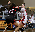 SIOUX FALLS, SD - MARCH 9: Liv Korngable #2 of the South Dakota Coyotes looks for help while being guarded by Josie Filer #25 of the Omaha Mavericks during the 2021 Women's Summit League Basketball Championship at the Sanford Pentagon in Sioux Falls, SD. (Photo by Dave Eggen/Inertia)