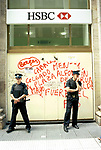Economic Turmoil in Argentina<br /> Police guard the boarded up HSBC bank in down time Buenos Aires. 2000s 2002