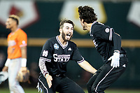 Mississippi State Bulldogs infielder Josh Hatcher (10) celebrates with Marshall Gilbert (34) after walking off Game 4 of the NCAA College World Series against the Auburn Tigers on June 16, 2019 at TD Ameritrade Park in Omaha, Nebraska. Mississippi State defeated Auburn 5-4. (Andrew Woolley/Four Seam Images)