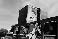 Teheran, Iran, April 6, 2007.Football fans en route for the Friday afternoon match pass by a giant mural depicting the late Ayatollah Khomeini.