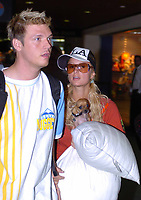 MIAMI, FL -  2004: Paris Hilton and her dog Tinker Bell along with boyfriend, Nick Carter At Miami International Airport in Miami, Florida in 2004<br /> <br /> People:  Paris Hilton, Nick Carter