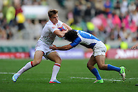 Tom Mitchell of England is tackled by Nicolas Bruzzone of Argentina during the iRB Marriott London Sevens at Twickenham on Saturday 11th May 2013 (Photo by Rob Munro)