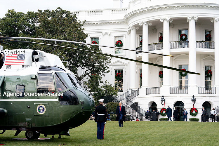 President Donald J. Trump walks across the South Lawn of the White House Saturday, Dec. 12, 2020, to board Marine One for his flight to Joint Base Andrews, Md., and begin his trip to attend the Army-Navy football game at the U.S. Military Academy in West Point, N.Y. (Official White House Photos by Tia Dufour)