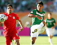 Carlos Salcido of Mexico hooks the ball away from Vahid Hashemaian of Iran. Mexico defeated Iran 3-1 during a World Cup Group D match at Franken-Stadion, Nuremberg, Germany on Sunday June 11, 2006.
