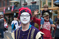 Man dressed up in jester outfit and white face-paint, Viking Fest 2016, Poulsbo, WA, USA.