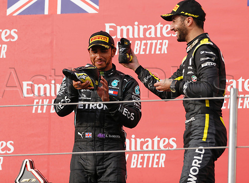 1st November 2020, Imola, Italy; FIA Formula 1 Grand Prix Emilia Romagna, Race Day;  44 Lewis Hamilton GBR, Mercedes-AMG Petronas Formula One Team shares drinking shoes with 3rd placed  3 Daniel Ricciardo AUS, Renault DP World F1 Team