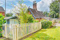 BNPS.co.uk (01202 558833)<br /> Pic: PropertyPublicity/BNPS<br /> <br /> Pictured: The cottage is in the village of Stone, Staffs<br /> <br /> Loco-cation, loco-cation, loco-cation..<br /> <br /> This quirky property that is up for sale is all about its loco-cation - as it sits on a railway crossing right next to the train tracks.<br /> <br /> The Grade II listed cottage was built in 1850 to house the gatekeeper whose job it was to close the gates at the road crossing whenever a train was due.<br /> <br /> The gates, in the village of Stone, Staffs, were automated many years ago.