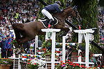 August 08, 2009: Thomas Ryan aboard Tamela C+P competing in the Puissance event. Land Rover International Puissance. Failte Ireland Horse Show. The RDS, Dublin, Ireland.