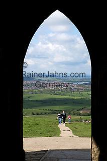 Great Britain, England, Somerset, Glastonbury: View over Somerset and Glastonbury through archway of tower of church of St Michael atop Glastonbury Tor