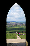 Great Britain, England, Somerset, Glastonbury: View over Somerset and Glastonbury through archway of tower of church of St Michael atop Glastonbury Tor