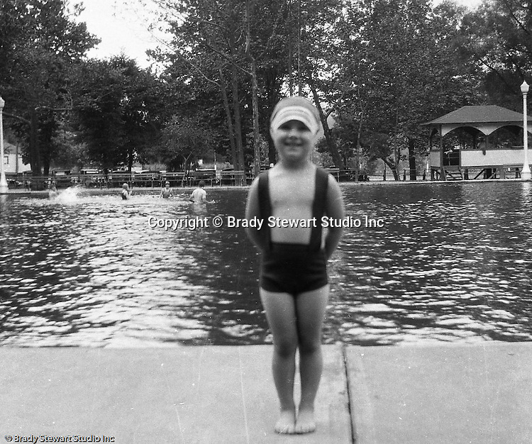 """South Park PA: Sally Stewart is ready to have fun at the new South Park Swimming pool. The philosophy of recreation in the '20s and '30s was different than it is today. The differences between the haves and the have-nots of society were understood differently, and the county parks were called """"the people's country clubs,"""" bringing to poorer people the same recreation that the wealthy paid for at private clubs: golf, tennis, swimming, picnicking. The parks offered common folk the chance to escape to rural campgrounds, day camps, and """"retreats."""" Certain modern recreational concepts had not yet arrived: people didn't """"swim,"""" they """"bathed""""; hence, a large South Park pool was only four feet deep at its deepest point."""